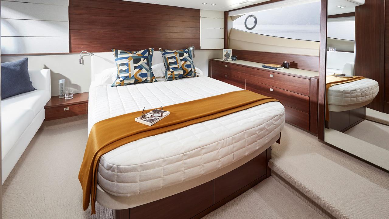 3-v50-open-interior-owners-stateroom-walnut-satin