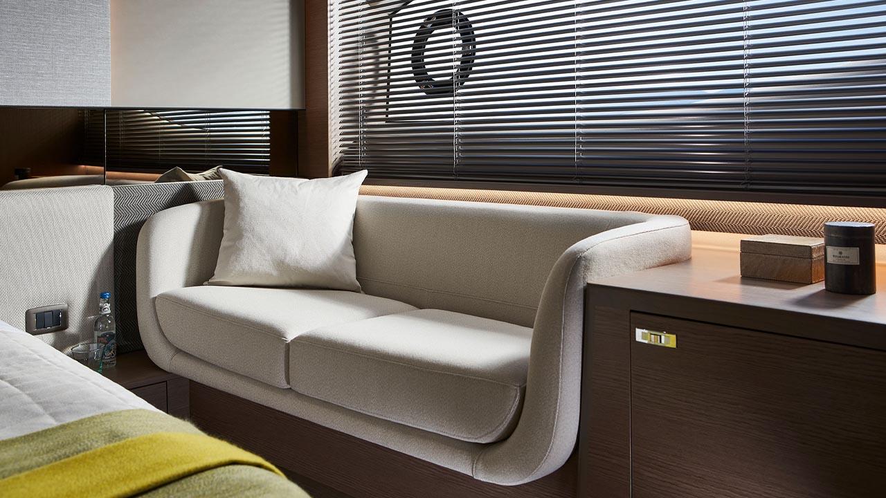 7-v55-interior-owners-stateroom-sofa-silver-oak-satin